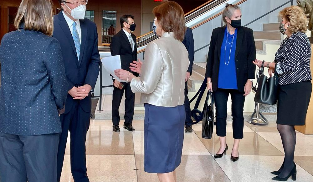 Ambassador Pascale Baeriswyl and Laetitia Courtois greet the guests, pictured here with Ambassador Zhang Jun, Permanent Representative of China.